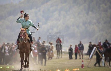 Lake Issyk-Kul, Kurgyzstan, 6th September 2018: Woman competing in archery on horseback game