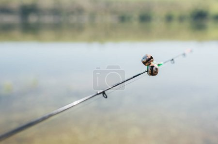 A fishermans rod reel and bells
