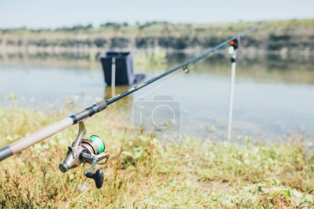Fishing tackle - fishing spinning, hooks and lures on sunshine outdoor