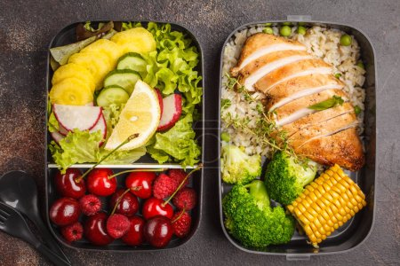 Photo for Healthy meal prep containers with grilled chicken with fruits, berries, rice and vegetables. Takeaway food jn dark background, top view - Royalty Free Image
