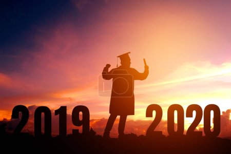 Photo for 2020 New year Silhouette young man graduation in 2020 years education congratulation concept ,Freedom and Happy new year - Royalty Free Image