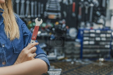 Photo for Young woman working in factory. Proud Female Mechanic. Girls can fix things too - Royalty Free Image