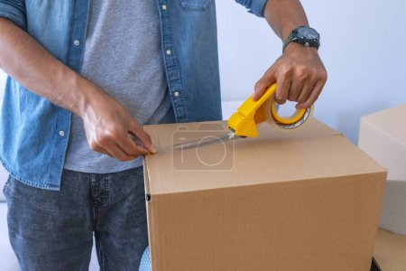 Photo for Close up of male packing cardboard box - Royalty Free Image