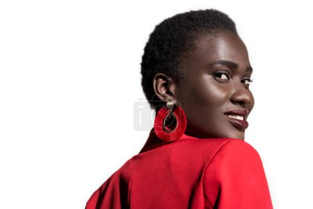 portrait of beautiful young stylish african american woman smiling at camera isolated on white