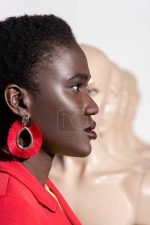 side view of beautiful stylish african american girl looking away on white