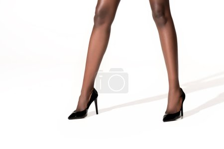 Photo for Cropped shot of beautiful african american woman in high heeled shoes on white - Royalty Free Image
