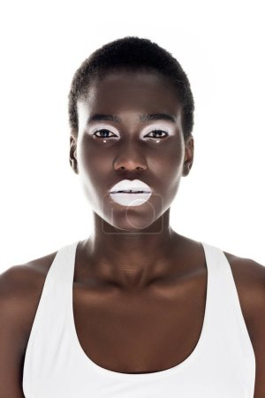 portrait of attractive tender african american girl with white makeup looking at camera isolated on white