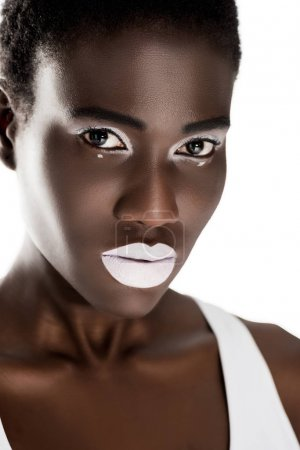 portrait of beautiful tender young african american woman with white makeup looking at camera isolated on white