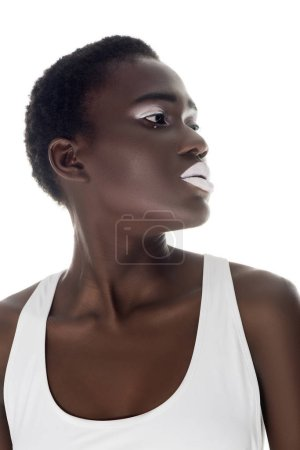 beautiful african american girl with white lips looking away isolated on white