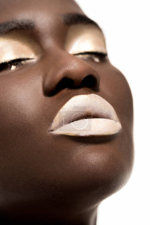 close-up portrait of beautiful sensual young african american woman with closed eyes and white makeup isolated on white