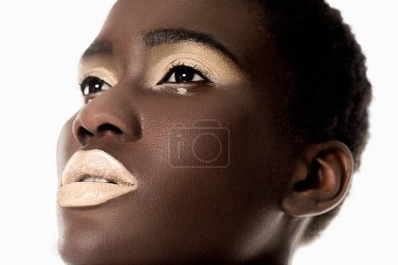 close-up portrait of beautiful sensual african american girl with white lips looking away isolated on white