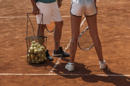 Photo for Cropped shot of couple in sportswear ready to play tennis on outdoor court - Royalty Free Image