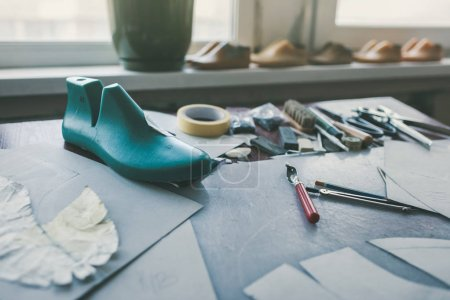 Photo for Different tools and shoe last at shoemaker workplace - Royalty Free Image