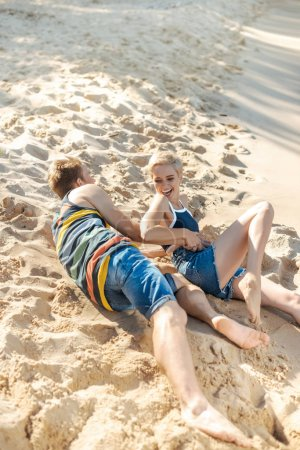 happy couple having fun together on sandy beach