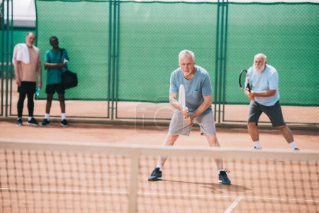 Photo for Selective focus of old sportsmen playing tennis on court - Royalty Free Image