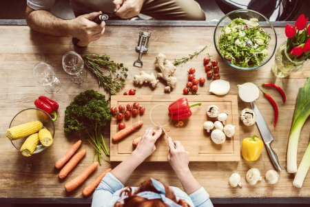 top view of couple at preparing healthy dinner kitchen table