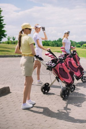 Photo for Female golfers with golf equipment walking at golf course - Royalty Free Image