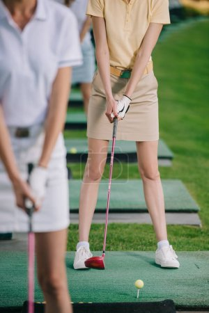 cropped shot of female golf players playing golf at golf course