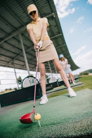 selective focus of women playing golf at golf course