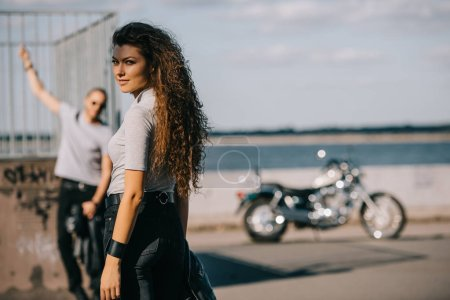 selective focus of girlfriend and boyfriend with classical motorbike