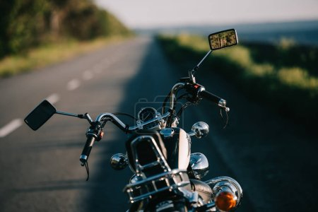 Photo for Cruiser motorbike standing on empty road - Royalty Free Image