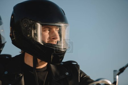 portrait of man in motorcycle helmet looking away