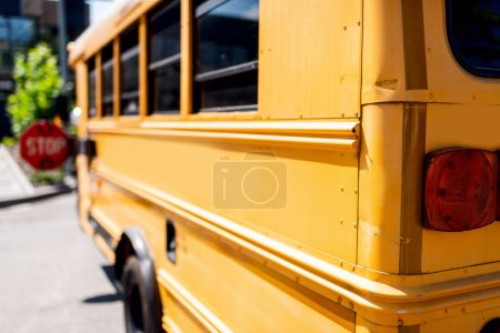 Photo for Partial view of traditional school bus with stop sign - Royalty Free Image