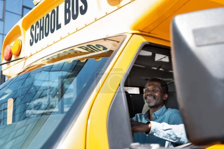 Photo for View through side window at mature african american bus driver - Royalty Free Image