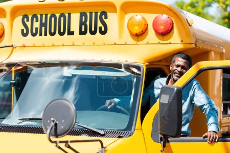 Photo for Handsome senior school bus driver looking at camera - Royalty Free Image