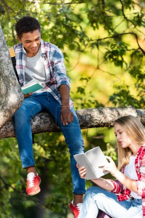 teen students couple reading books after school