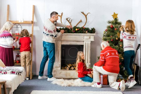 big family decorating living room for christmas together