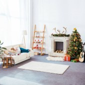 young woman sleeping on couch in christmas decorated living room