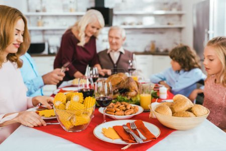 big family having thanksgiving dinner together at home
