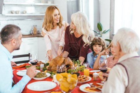 big happy family having thanksgiving dinner together at home