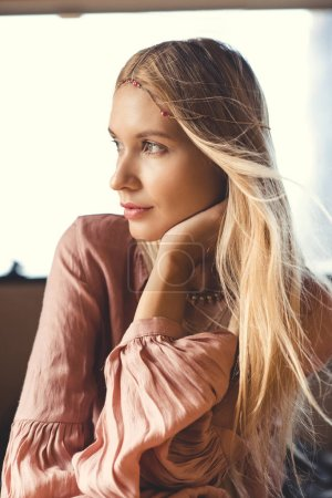 attractive blonde hippie girl in hair decoration