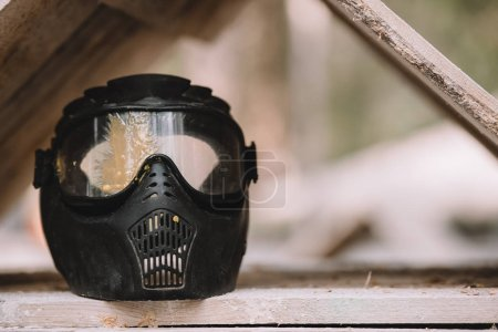close up view of goggle mask covered by paintball splash outdoors
