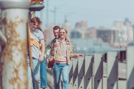 Photo for Tourists walking on street while traveling together - Royalty Free Image