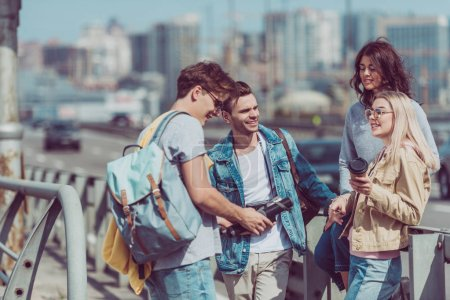 young tourists with backpacks traveling together