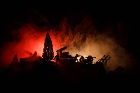 Photo for War Concept. Military silhouettes fighting scene on war fog sky background, World War Soldiers Silhouettes Below Cloudy Skyline At night. Attack scene. Armored vehicles. Selective focus. Decoration - Royalty Free Image