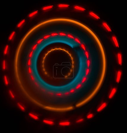 Photo for Music concept. Freezelight glowing vinyl on dark background or Turntable playing vinyl with glowing abstract lines concept on dark background. For Club poster Design - Royalty Free Image