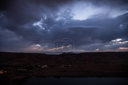 Photo for Dark prestorm clouds in summer sky - Royalty Free Image