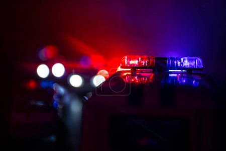 Photo for Police cars at night. Police car chasing a car at night with fog background. 911 Emergency response police car speeding to scene of crime. Selective focus - Royalty Free Image