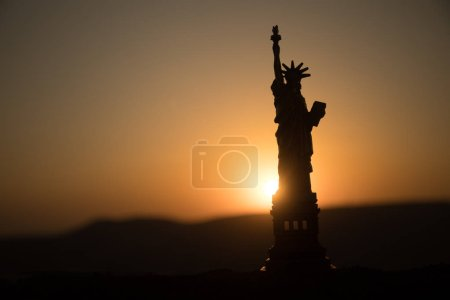 Statue of Liberty on the background of colorful dawn sky. Table decoration