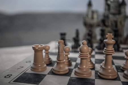 Chess board game concept of business ideas and competition. Chess figures on a chessboard. Outdoor sunset background.