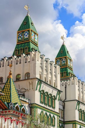 Moscow, Russia - August 06, 2018: Watchtowers above main entrance to the territory of Izmailovo Kremlin on a background of cloudy blue sky. Cultural and entertainment complex Kremlin in Izmailovo in Moscow