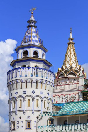 Moscow, Russia - August 06, 2018: Watchtowers of Izmailovo Kremlin on a background of blue sky closeup. Cultural and entertainment complex Kremlin in Izmailovo in Moscow