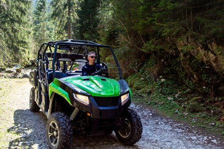 Photo for A tour group travels on ATVs and UTVs on the mountains. - Royalty Free Image