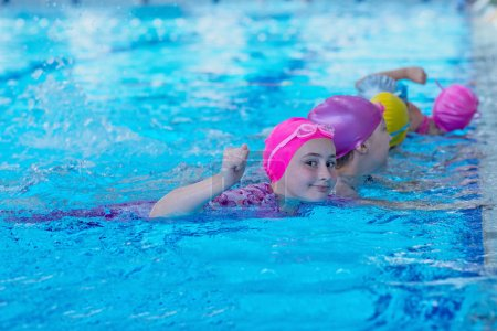 Photo for Happy kids at the swimming pool. young and successful swimmers pose - Royalty Free Image