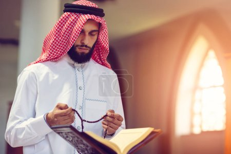 Photo for Religious muslim man praying inside the mosque. - Royalty Free Image