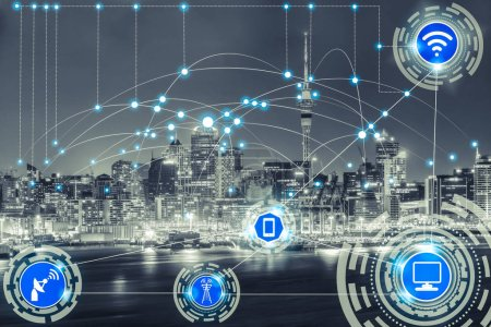 Photo for Smart city wireless communication network with graphic showing concept of internet of things ( IOT ) and information communication technology ( ICT ) against modern city buildings in the background. - Royalty Free Image